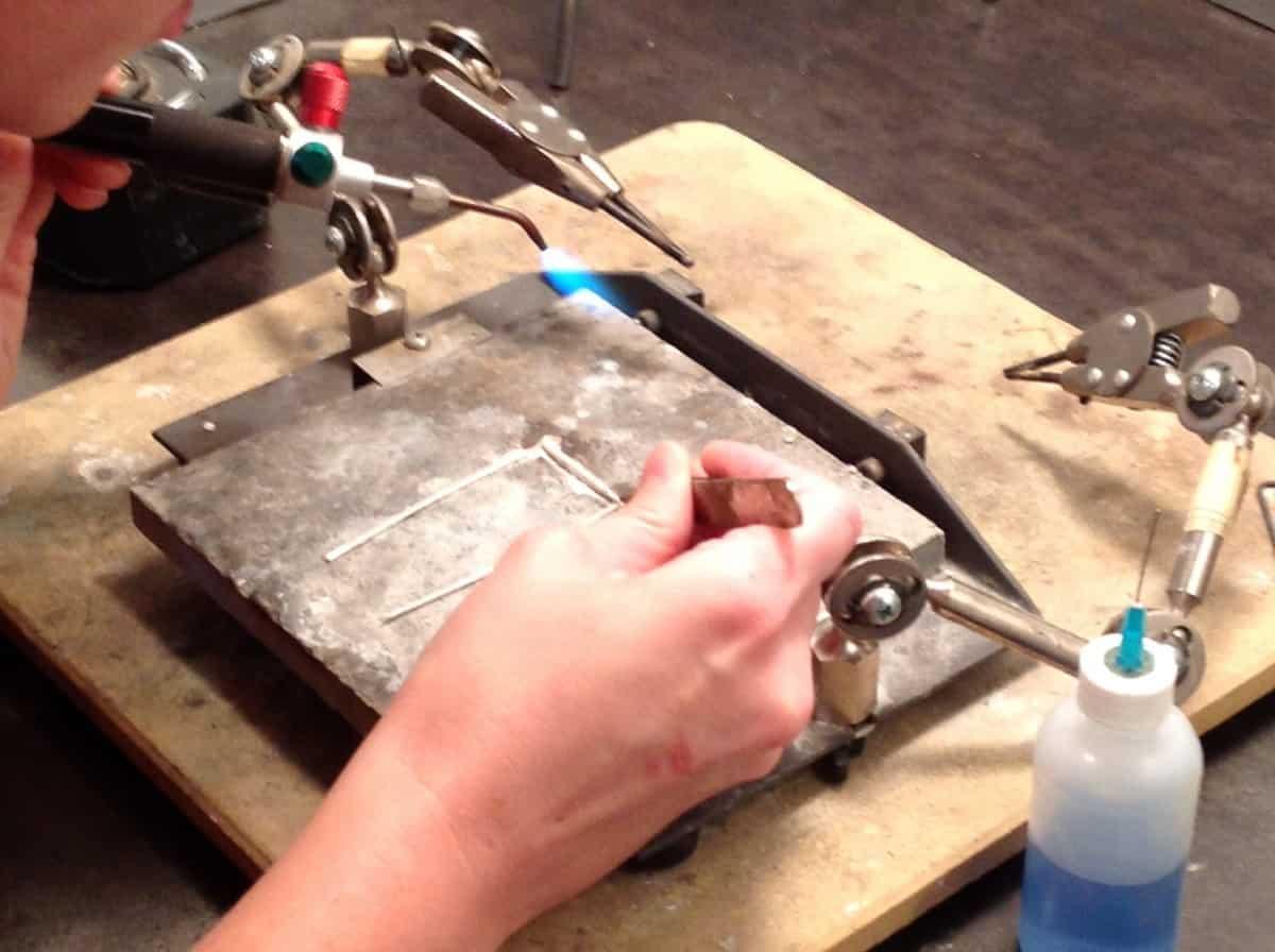 Valerie Heck soldering for Michelle Pajak-Reynolds