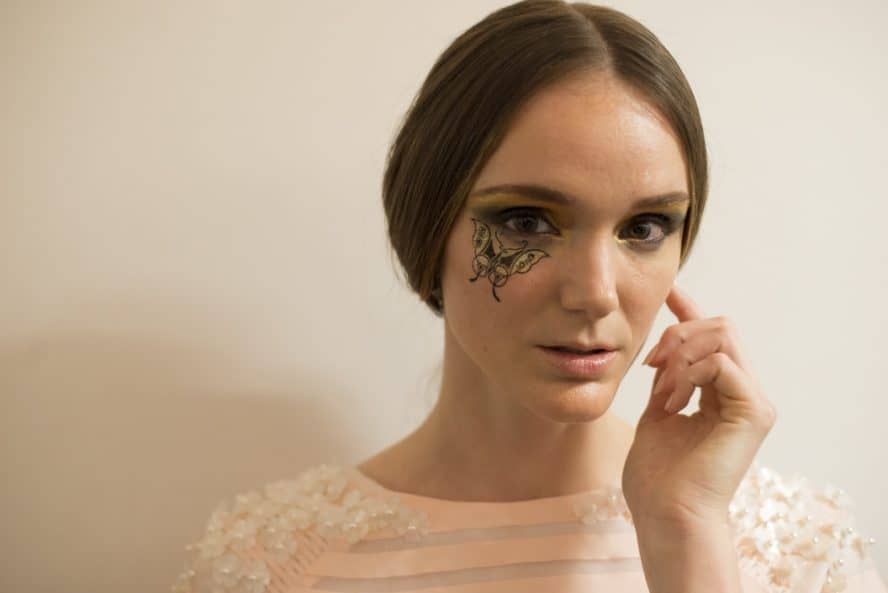 A model in butterfly runway makeup from the Dan Liu NYFW collection