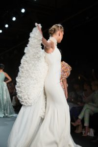 A winged model walking the runway during the John Paul Ataker NYFW collection