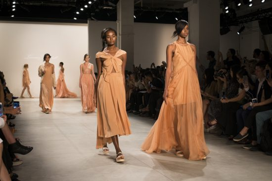 Models in orange on the runway of the Leanne Marshall NYFW SS17 collection