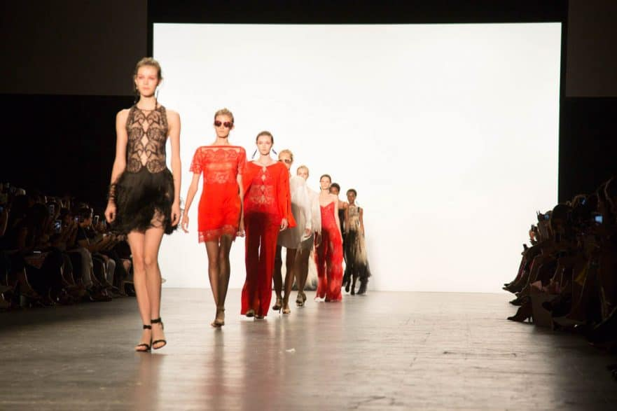 Models on the runway of Tadashi Shoji's NYFW show. Photo by JULEIMAGES.