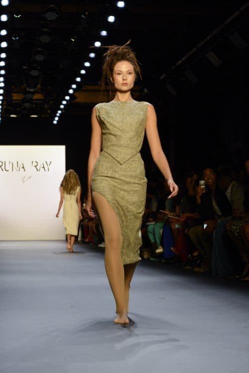 A model presenting a look from the Runa Ray NYFW collection on the runway.
